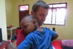 My husband enjoying some quiet time with an orphan.  This young boy's mother died when he was four months old and his family was unable to afford formula.