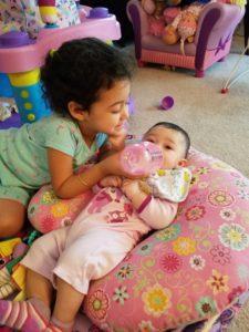 Sofia feeding Olivia