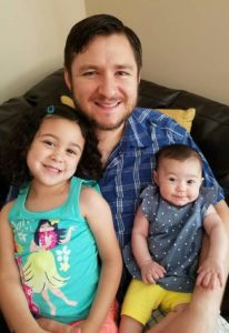 My husband with our two daughters.