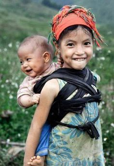 A sibling wears a baby in Vietnam