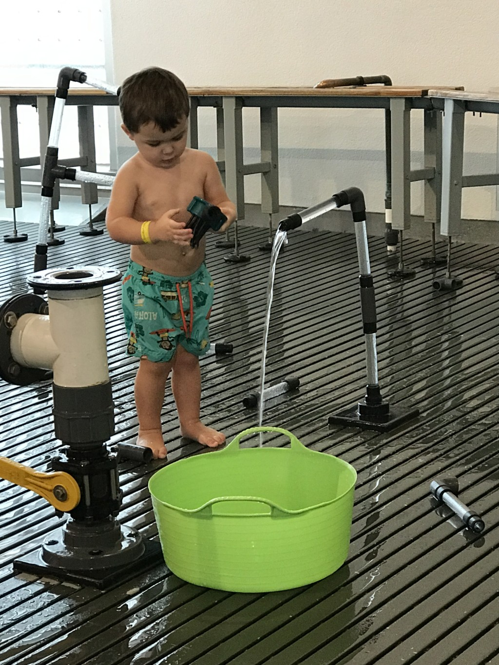 Child playing with water fountain at the Pittsburgh Children's Museum
