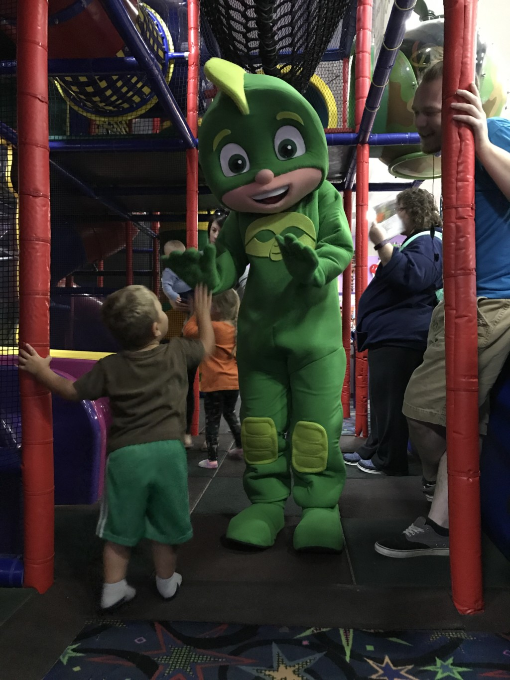 Small child high-fiving cartoon actor