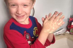 TJ washing away germs!