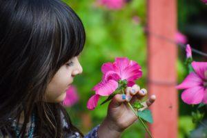 girl breathing flowers