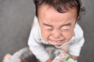 Toddler crying with eyes squeezed shut