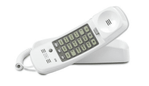 White tabletop phone with cord